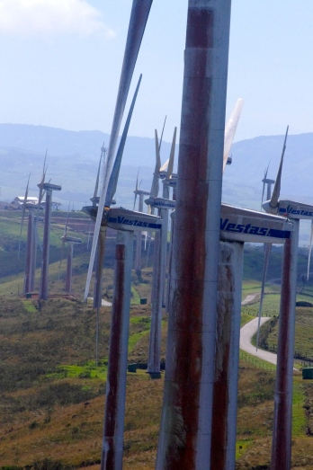 Wind turbines soar above the Costa Rican landscape on Thursday, Jan.3, 2013. The turbines are part of a government-operated wind farm and have been in use since 2003. (Missouri School of Journalism/Aaron Braverman)
