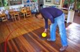 Francisco Burgos, director of the Monteverde Friends School, demonstrates a traditional kindergarden birthday party activity where students walk around the yellow ball, representing the sun, with a small globe, simulating one full year, Monday, Jan. 7, 2013. The School was founded in 1951. (Missouri School of Journalism/Aaron Braverman)