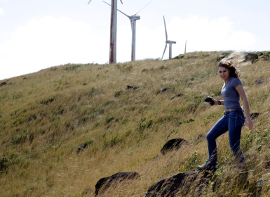 Missouri School of Journalism student Meg Pulling shoots video of wind turbines on Thursday, Jan. 3, 2013, in La Tejona, Costa Rica. Sally French/Missouri School of Journalism
