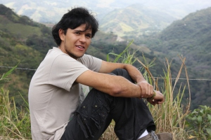 Randy Chinchilla sits on an overlook at the Bellbird Biological Corridor area, which begins in Monteverde. Chinchilla recently became the coordinator of the corridor.